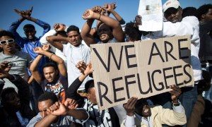 African migrants take part in a rally